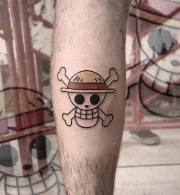 skull tattoo, one piece, one piece logo, light art tattoo, women tattooer