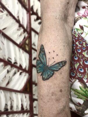 butterfly tattoo, oma tattoeage, oma, light art tattoo, women tattooer