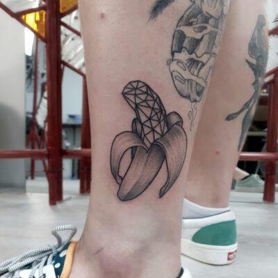 banana tattoo, geometric tattoo, leg tattoo, light art tattoo, women tattooer
