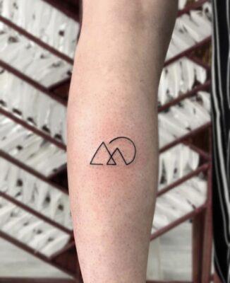 hills tattoo, sunset tattoo, symbol tattoo, light art tattoo, women tattooer